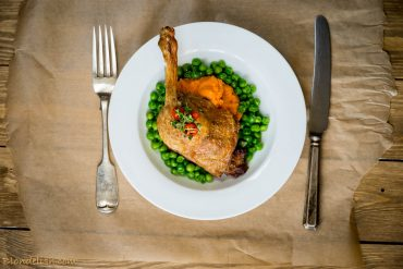 Duck with sweet potato puree and garlicky peas