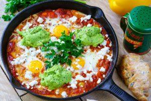 Shakshuka with cherry tomatoes avocado and cheese