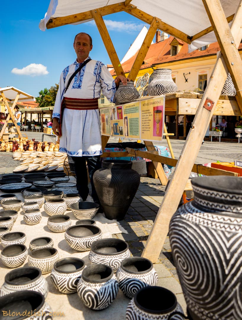 Traditional dressed men, selling pottery at the Pottery Festival in Sibiu, Transylvania