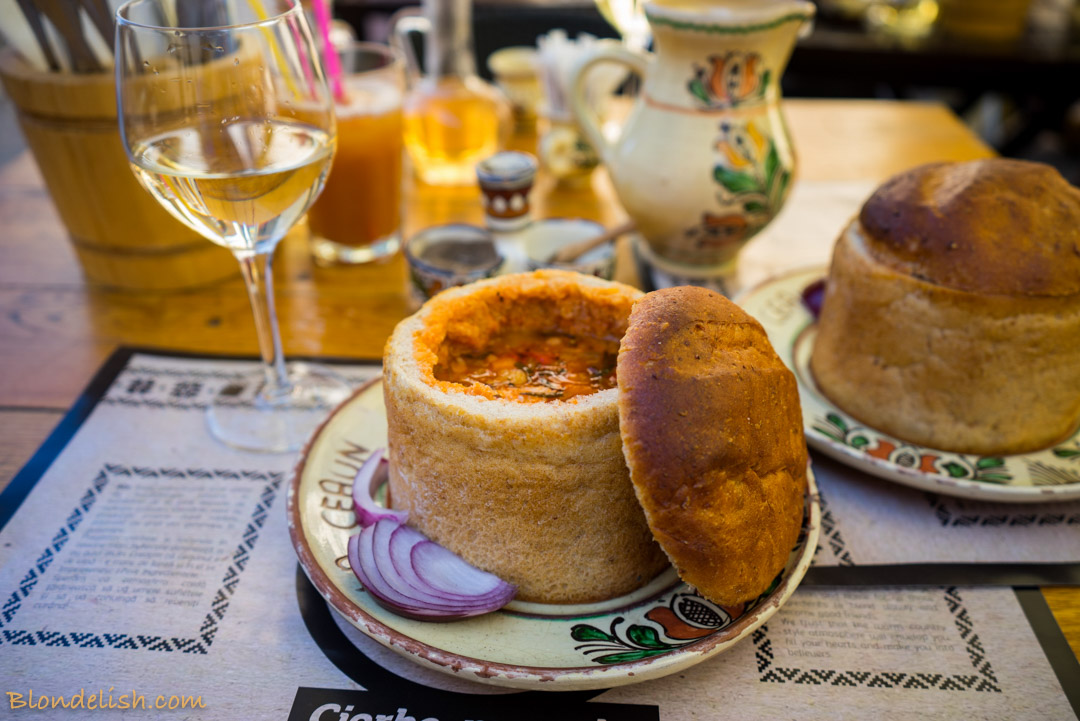 Romanian Beans and smoked pork soup, served in bread