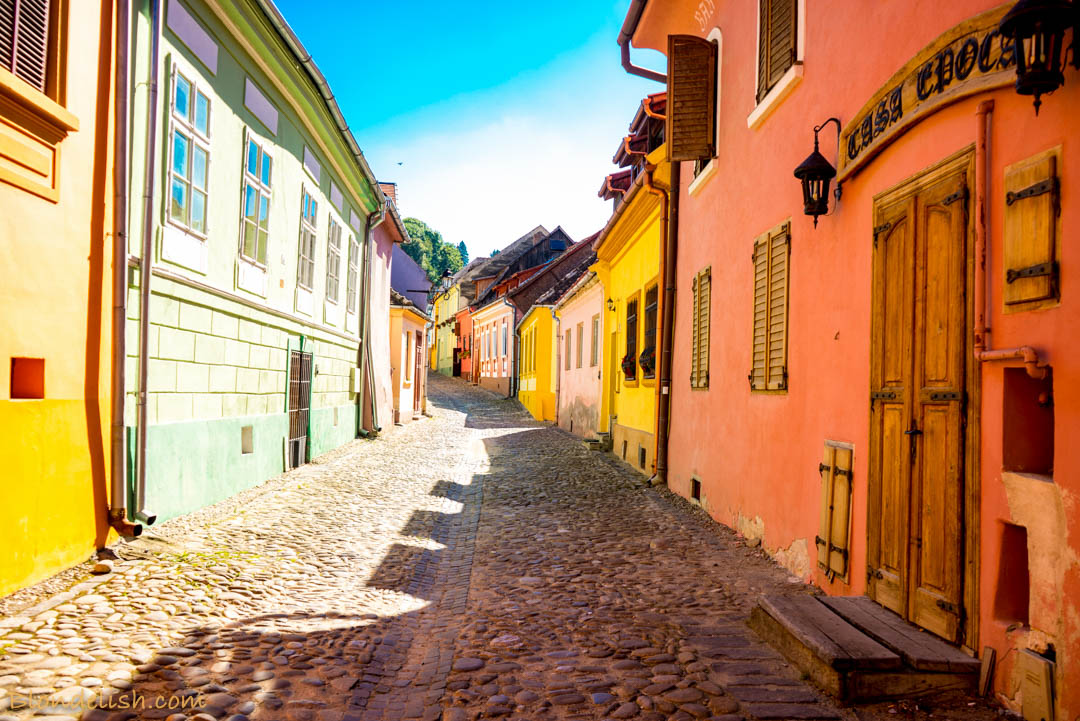 Streets with colourful houses of Sighisoara, Transylvania, Romania