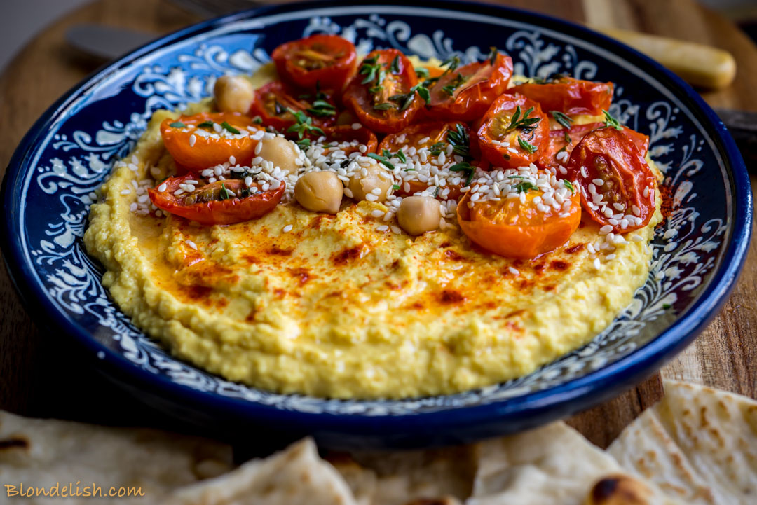 Hummus with turmeric and roasted cherry tomatoes recipe