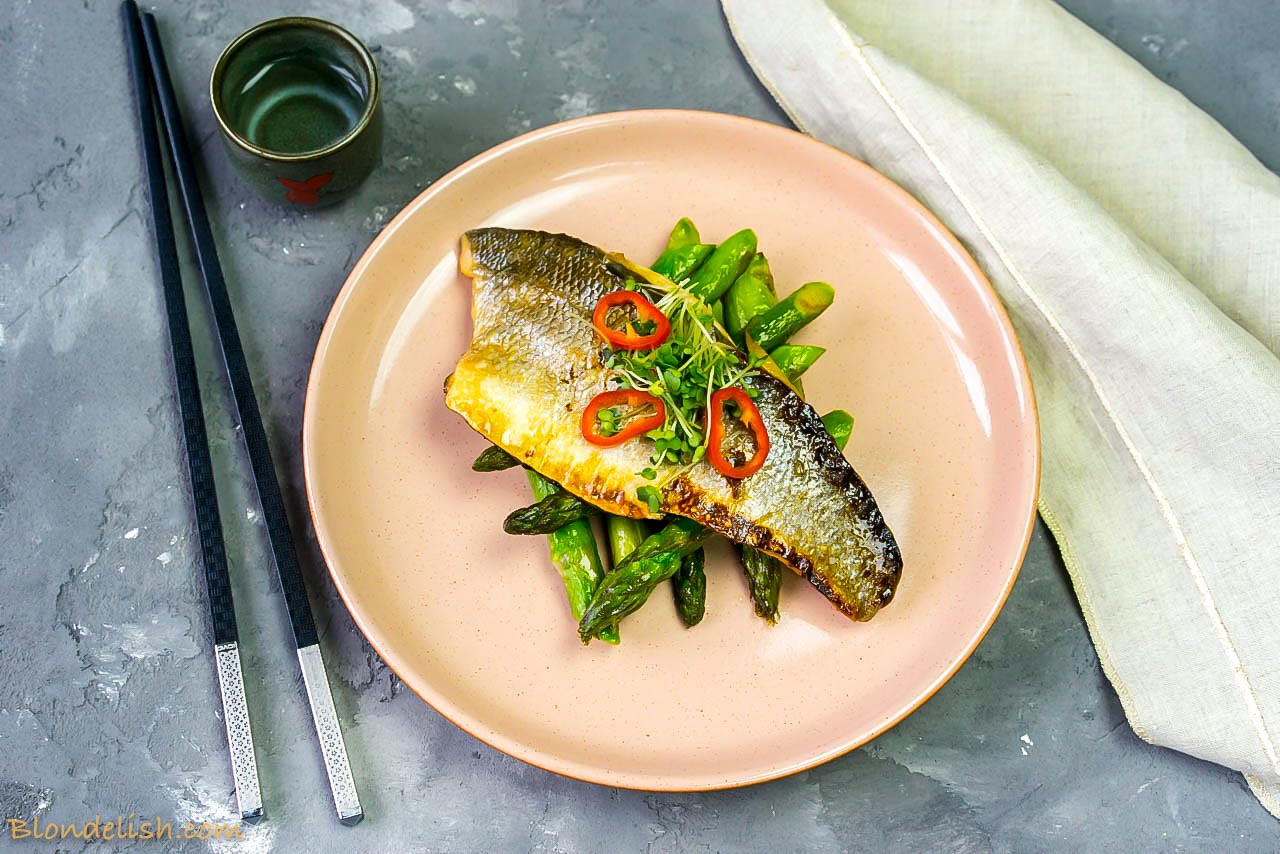 Japanese marinated sea bass with asparagus and chilli