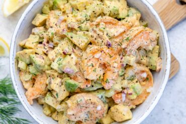 close up on a white bowl with keto shrimp and avocado salad